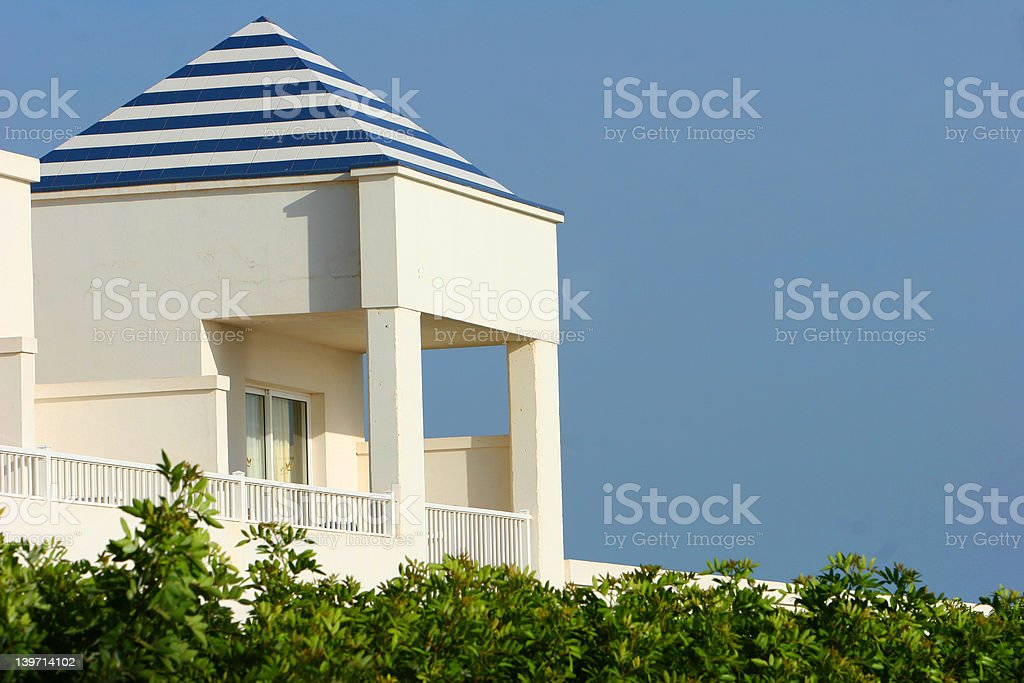 white house with striped roof stock photo