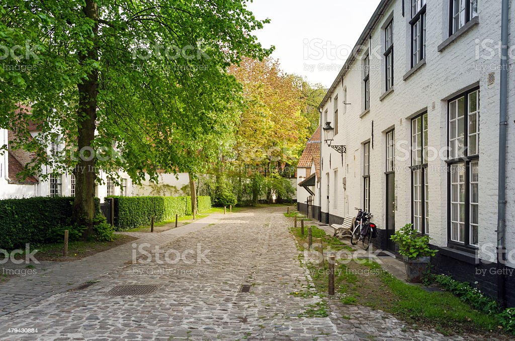 White houses in the Beguinage (Begijnhof) in Bruges stock photo