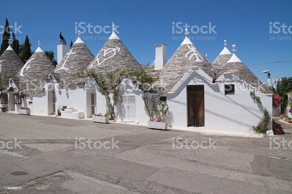 White houses with symbols in Alberobello, Puglia, Italy  stock photo
