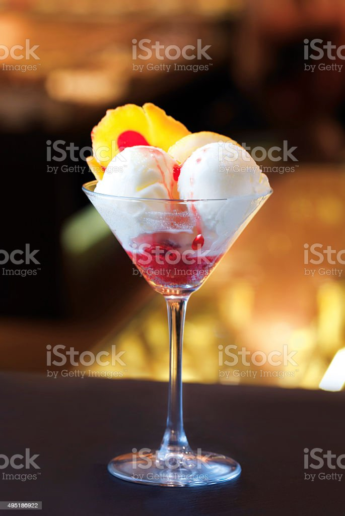 white ice cream in a glass at night stock photo