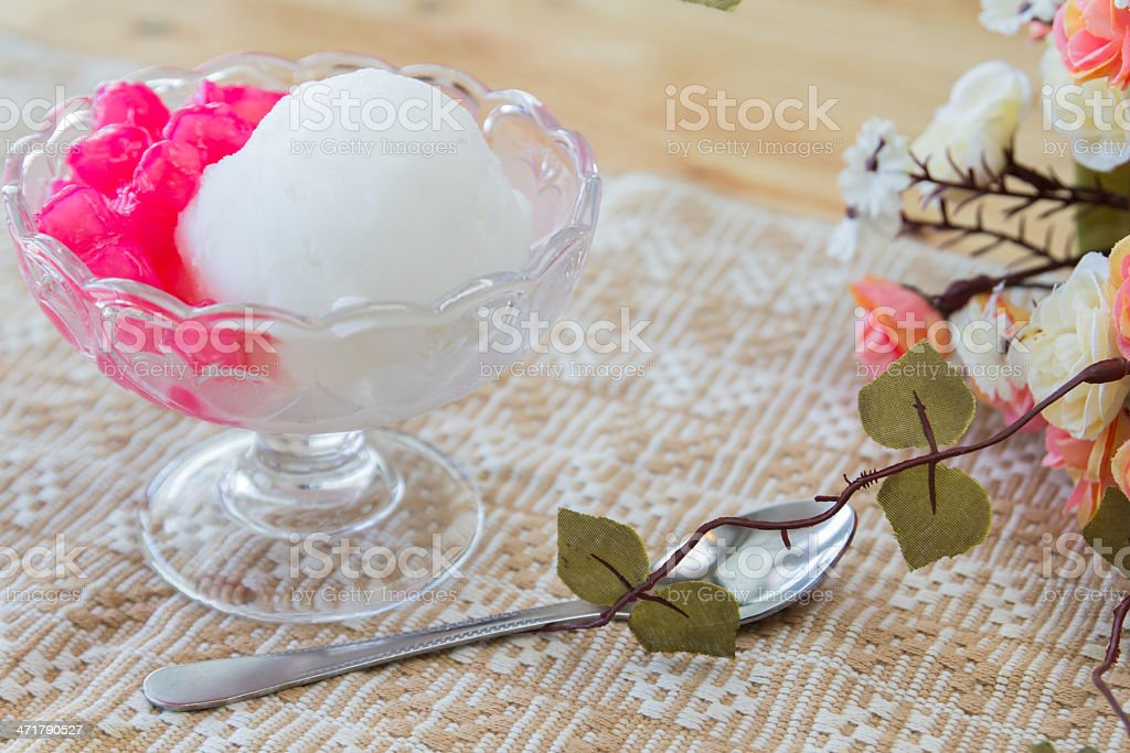 White ice cream made from coconut and pink jelly topping stock photo