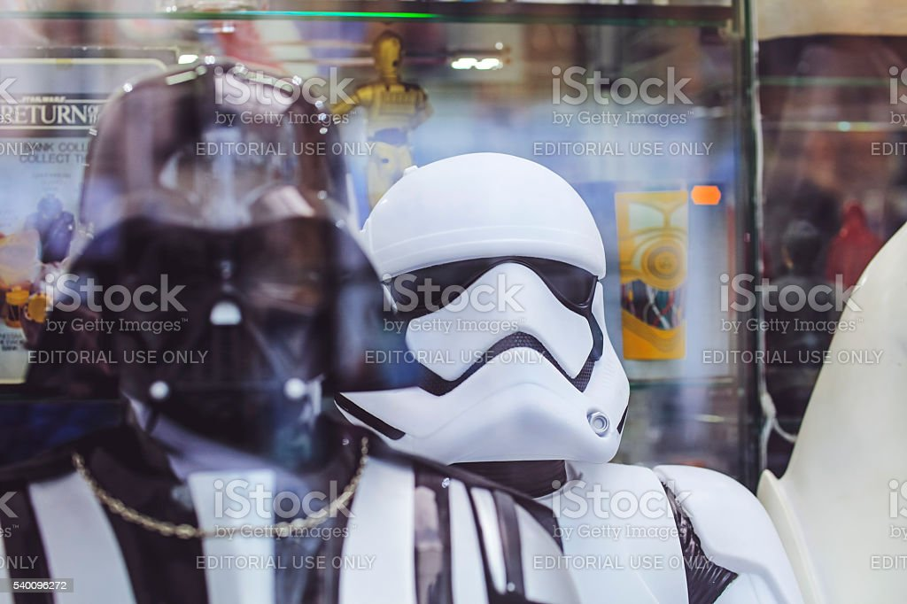 White Imperial Stormtrooper action figure and Darth Vader stock photo