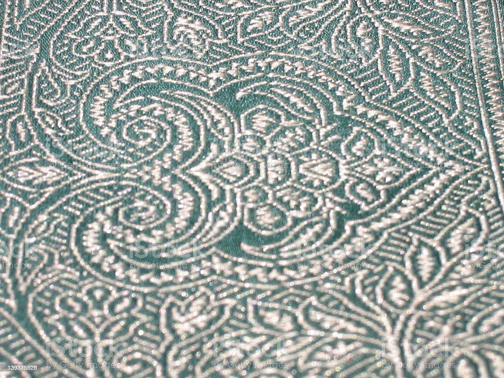 white indian pattern on green sari border (close-up) royalty-free stock photo