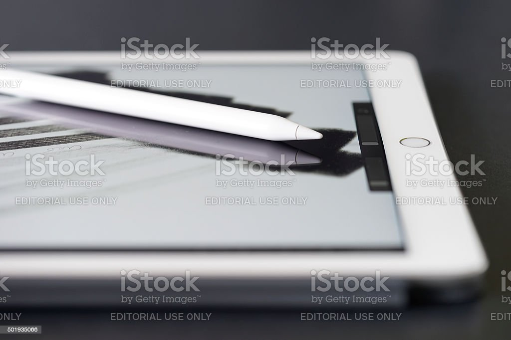 White iPad Pro with Apple Pencil stock photo