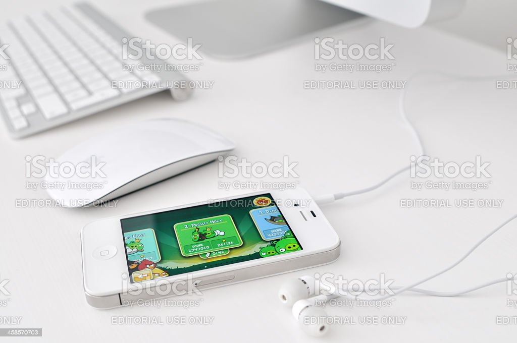 White iPhone 4 with Angry Birds on the screen royalty-free stock photo