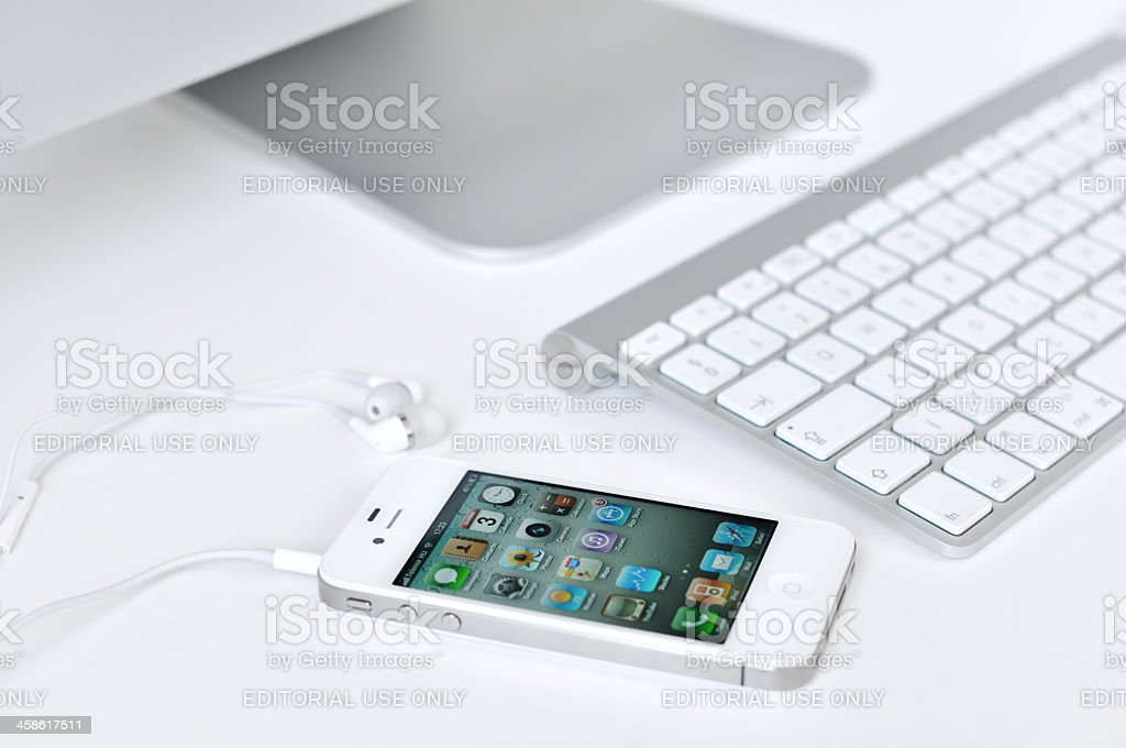 White iPhone 4 with headphones stock photo