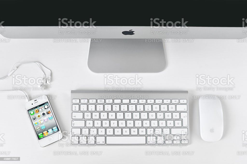 White iPhone 4 with iMac royalty-free stock photo