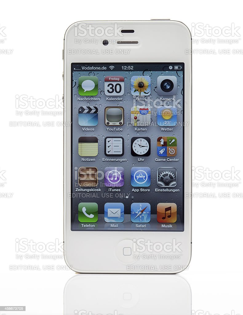 White iPhone 4S with German main page royalty-free stock photo