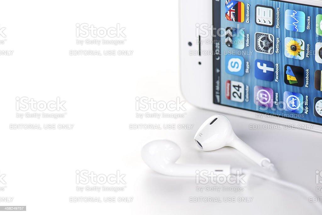 White iPhone 5 headphones royalty-free stock photo