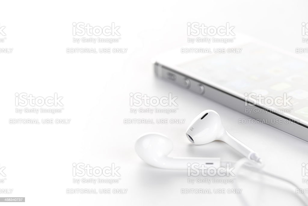 White iPhone 5 headphones royalty-free stock photo