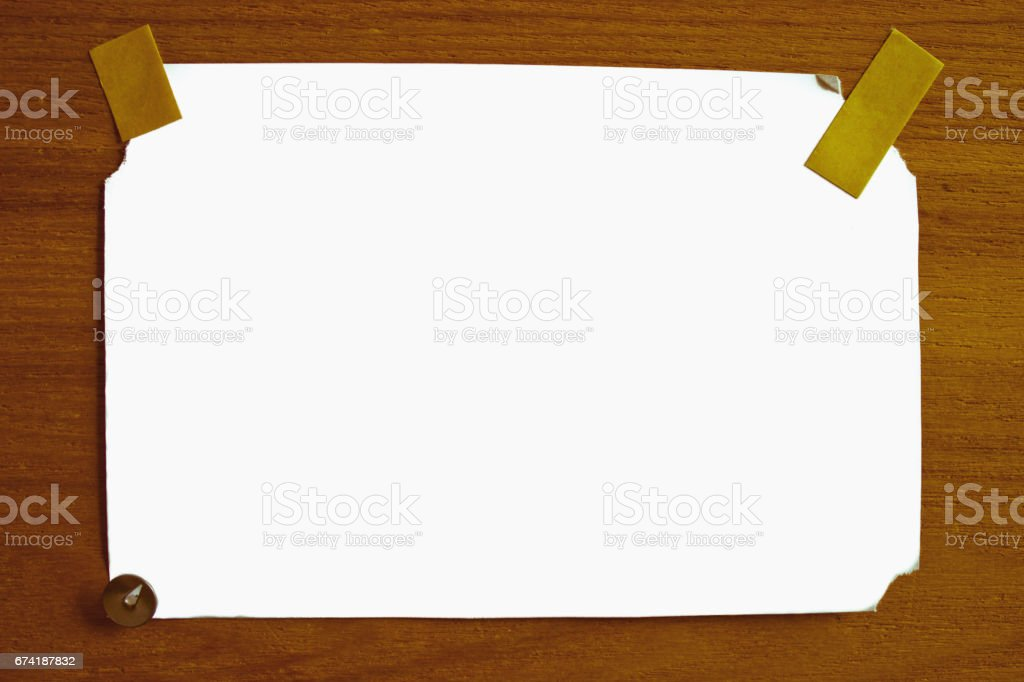 White isolated sheet of paper on a wooden surface stock photo