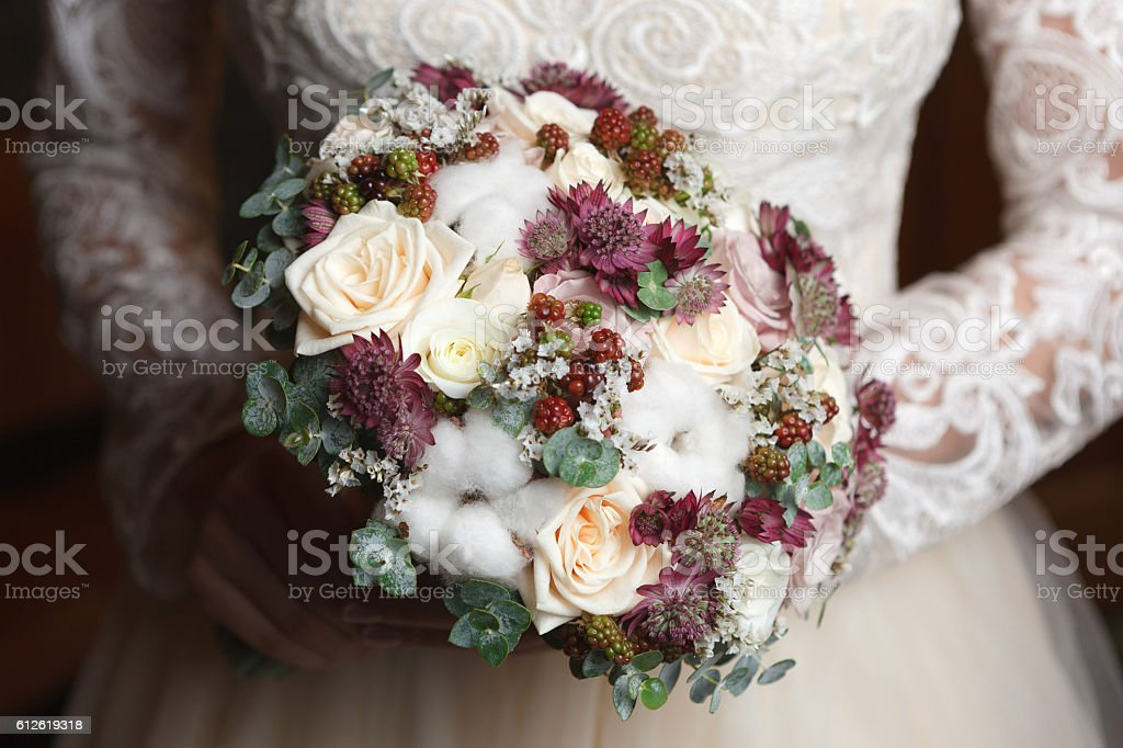 White, ivory and dusty pink bridal bouquet stock photo