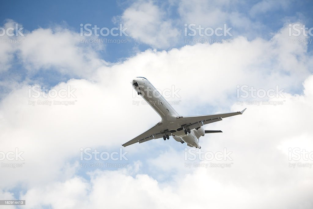 white jet airplane landing royalty-free stock photo