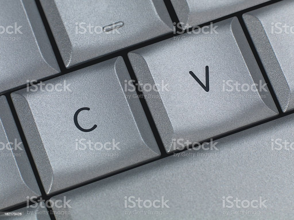 A white keyboard zoomed in on the C and V keys royalty-free stock photo
