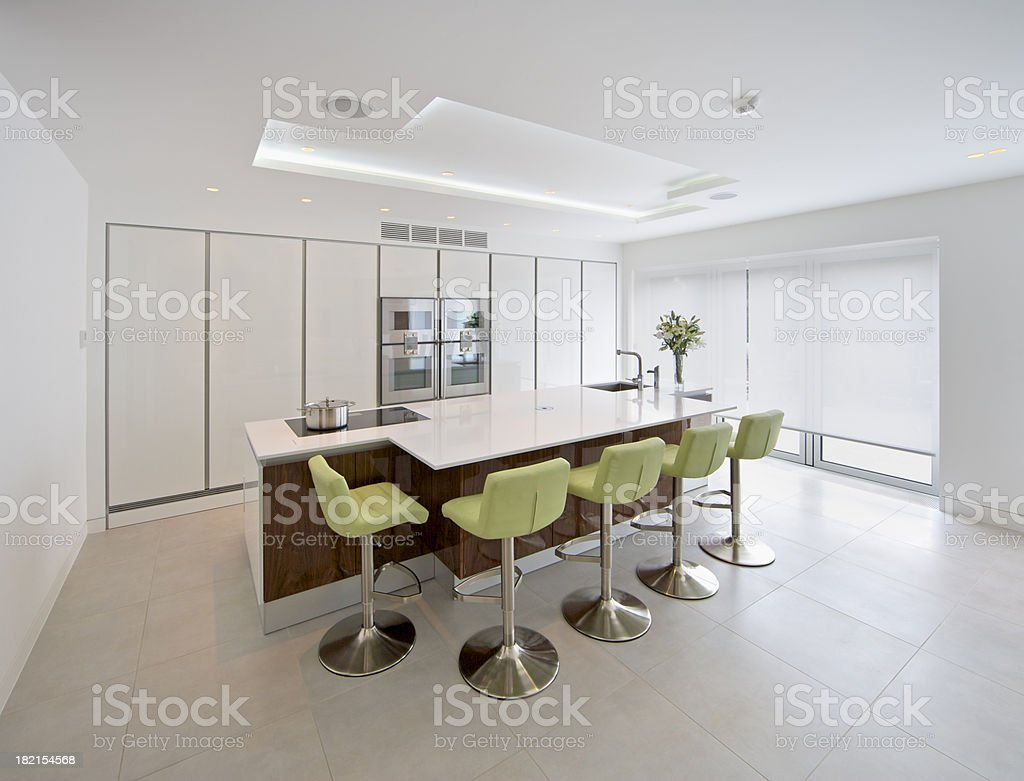 white kitchen and green stools royalty-free stock photo
