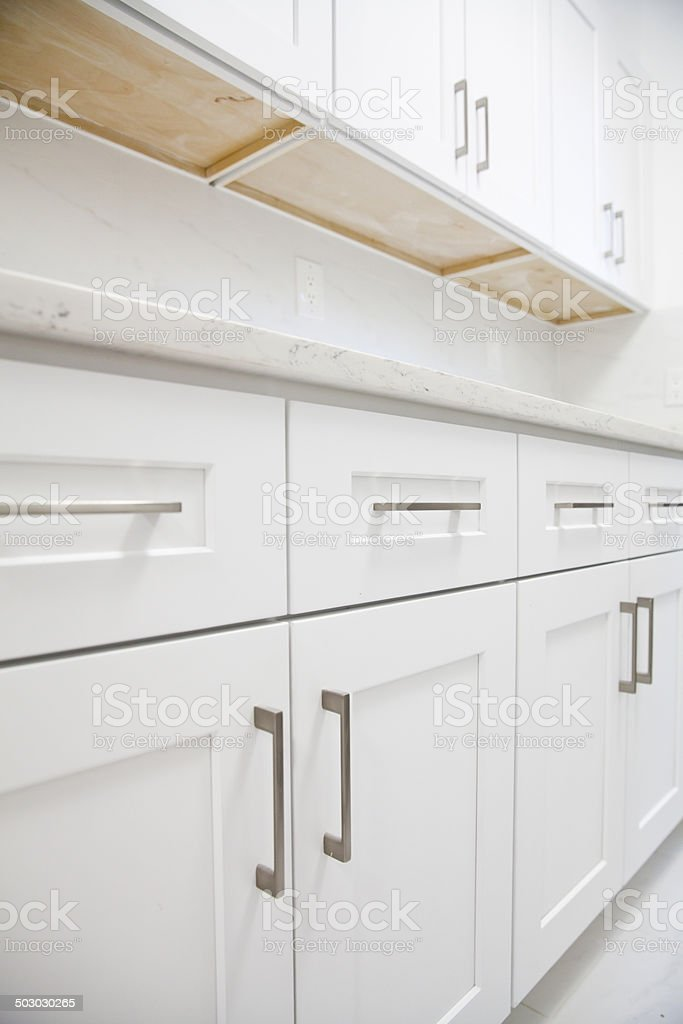 White kitchen cabinet stock photo