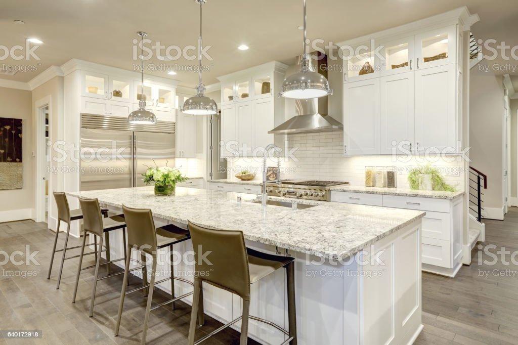 White kitchen design in new luxurious home stock photo