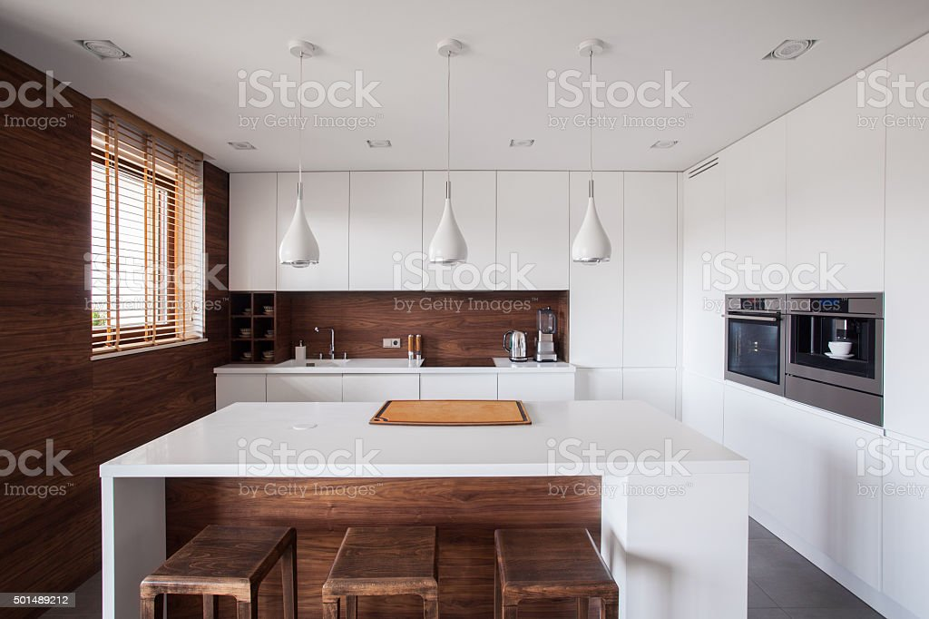 White kitchen island stock photo