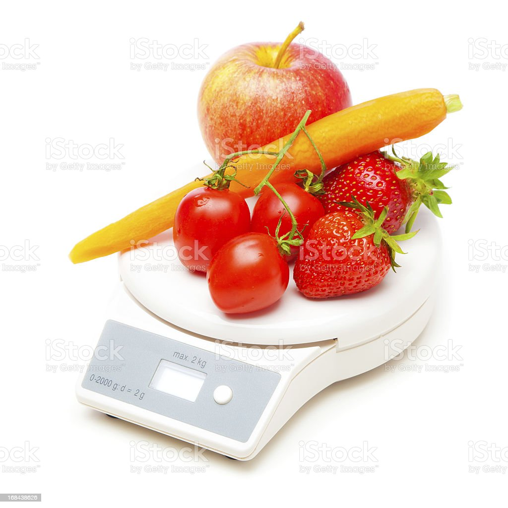 white kitchen scale with fruit and veggies stock photo