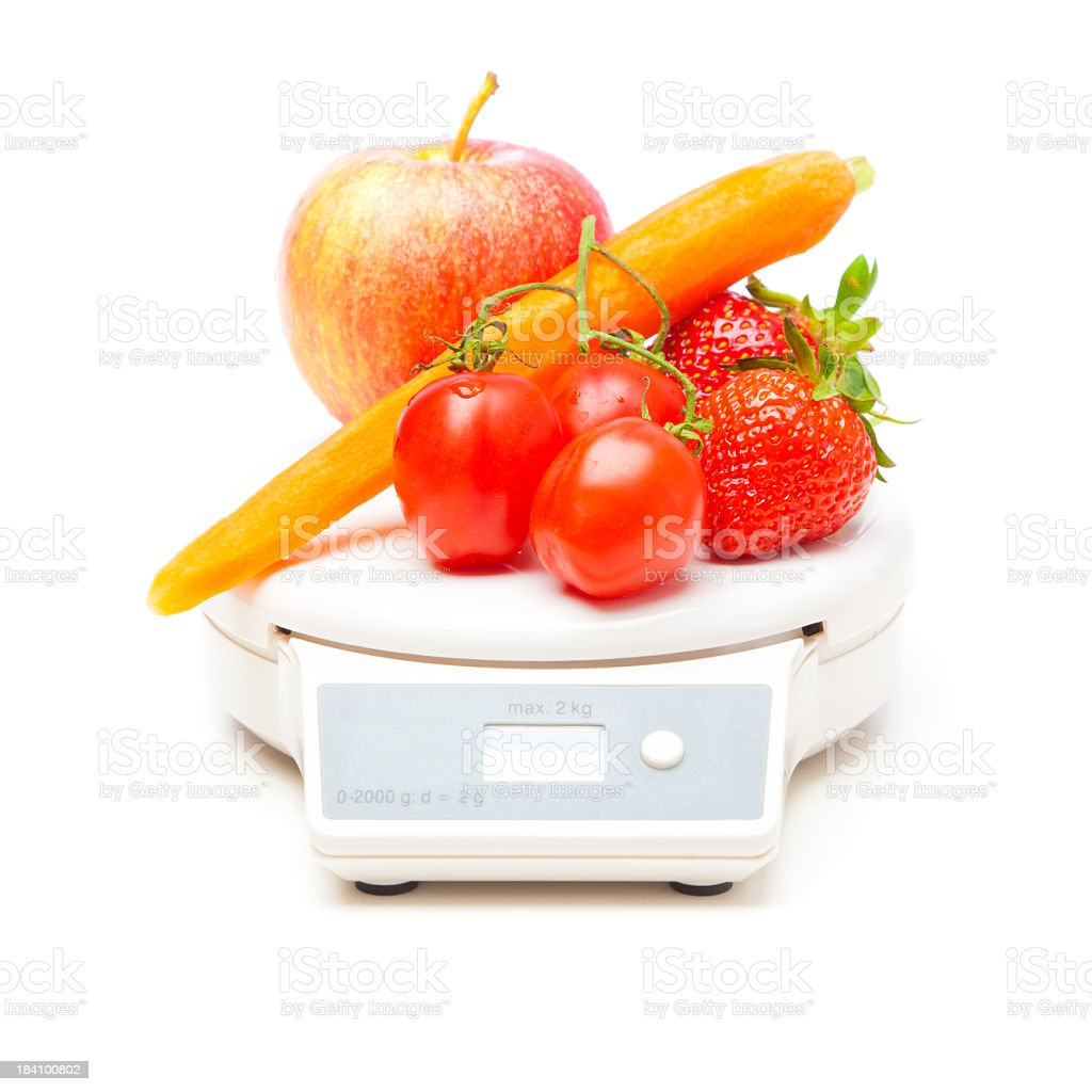 white kitchen scale with fruit and veggies royalty-free stock photo