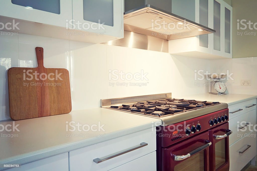 White kitchen with retro vintage burgundy oven stock photo