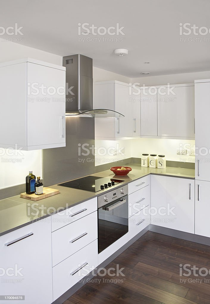 white kitchen with wood floor royalty-free stock photo