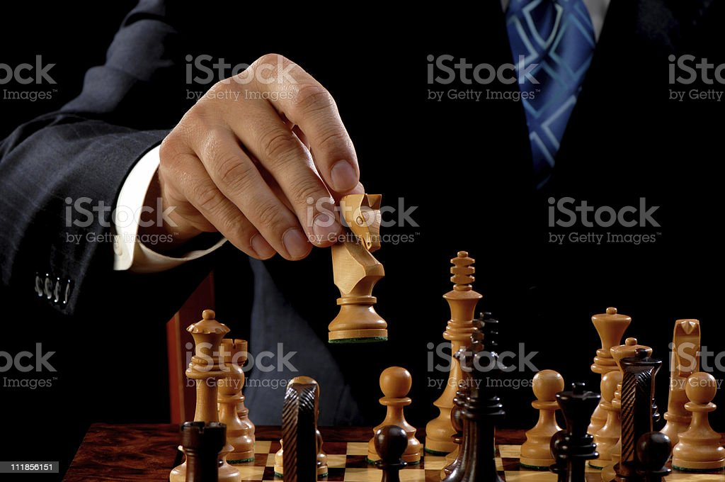 White Knight Chess Piece on Opening Move stock photo