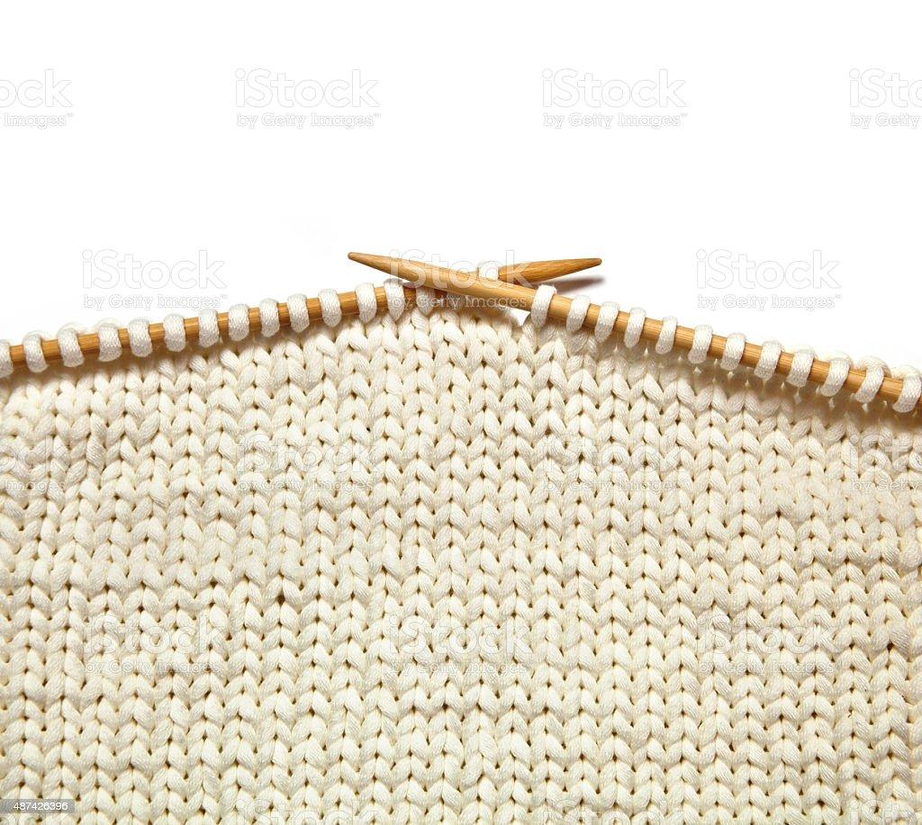 White knitting on white background stock photo