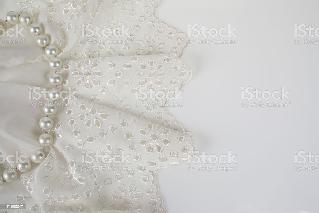 White lace and pearls stock photo