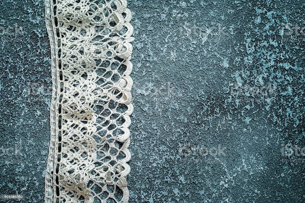 White lace on a dark cement background with copy space stock photo