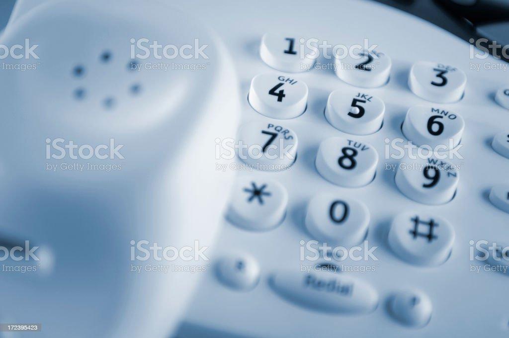 White landline telephone with keypad as focal point stock photo
