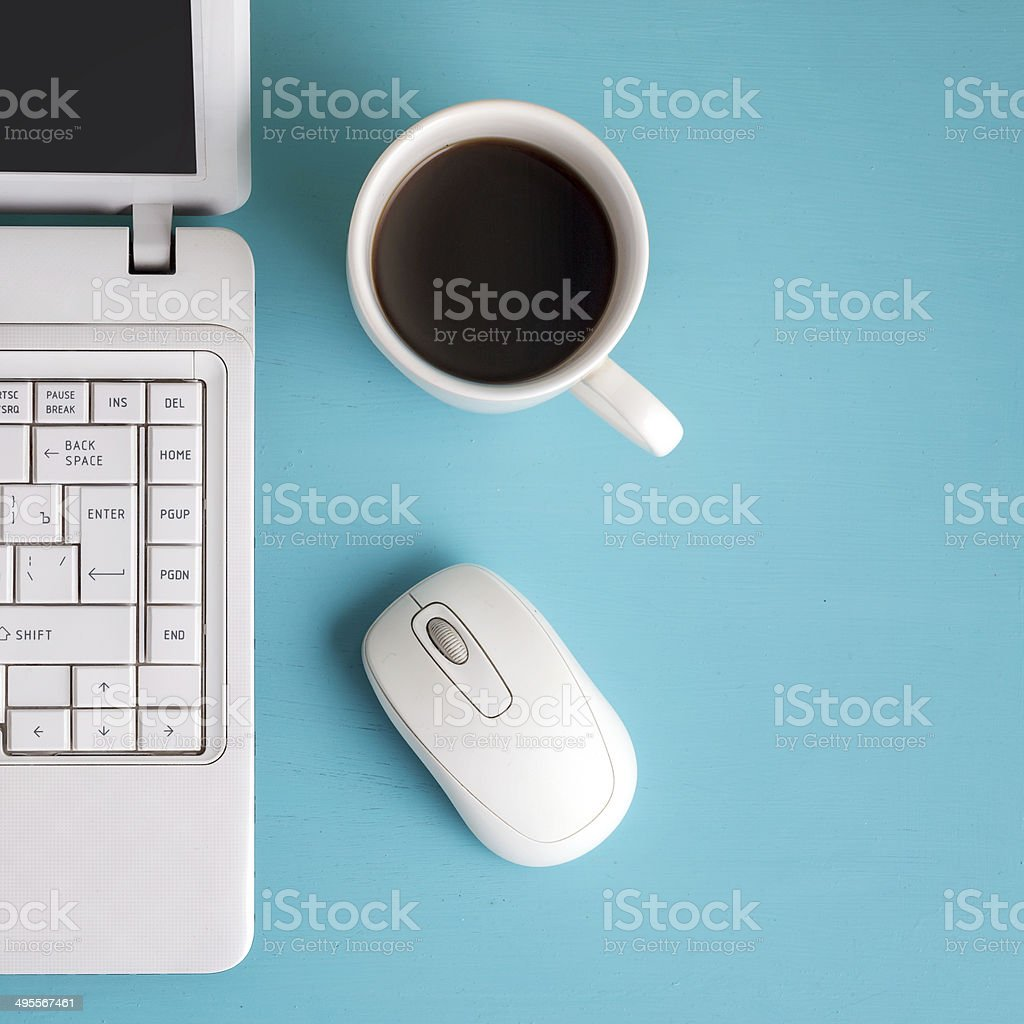 White laptop on table - place for text. stock photo