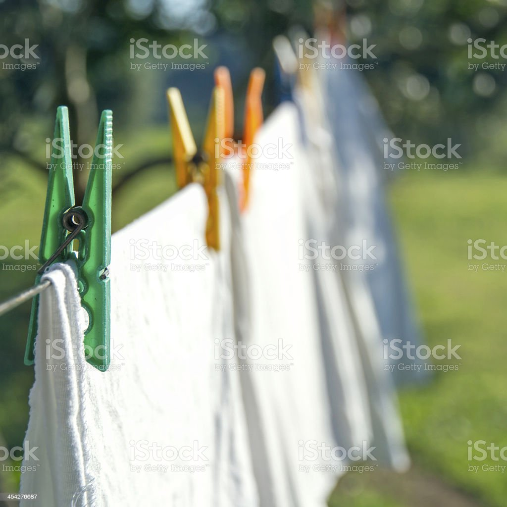 White laundry drying on a clothesline stock photo