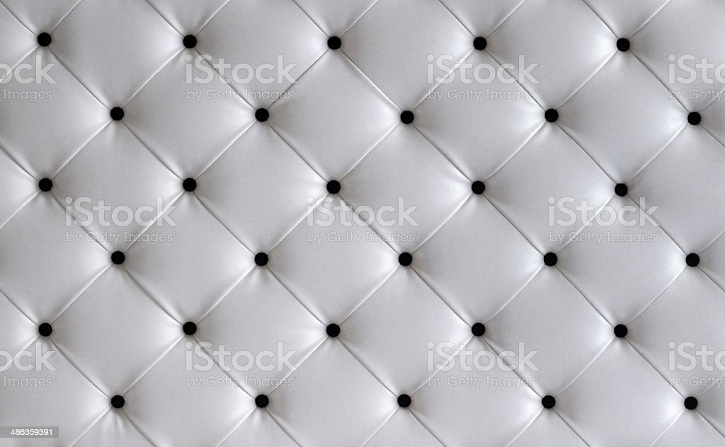 White leather button headboard background stock photo