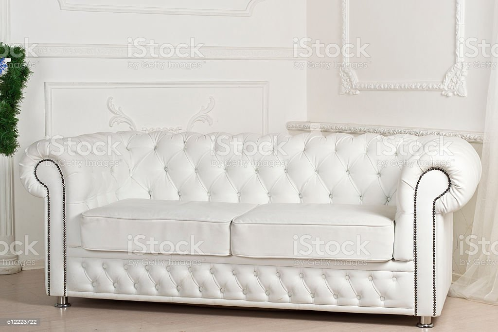 White leather sofa in Christmas decorations stock photo