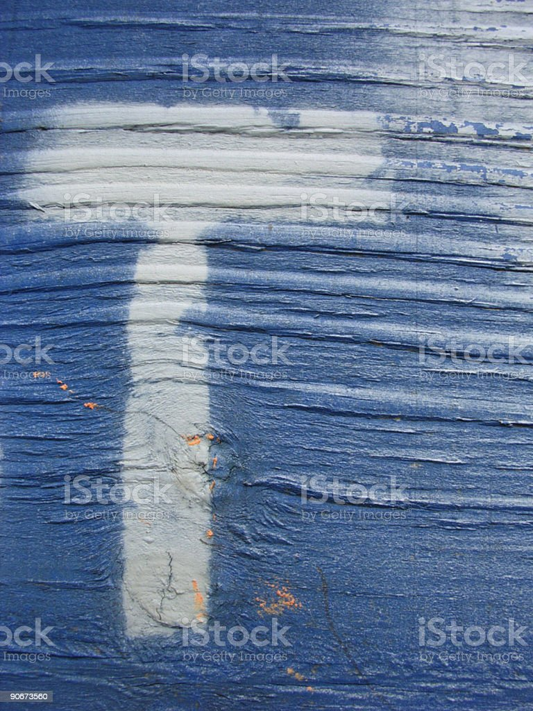 White Letter T Painted on Blue Wood royalty-free stock photo