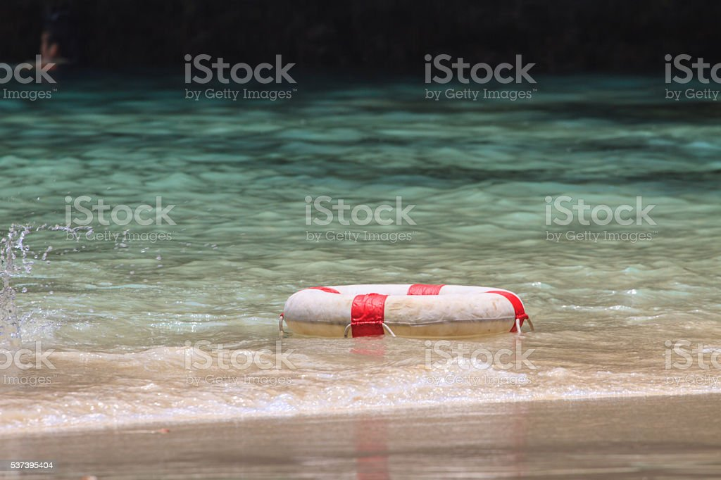 White life buoy in the water stock photo