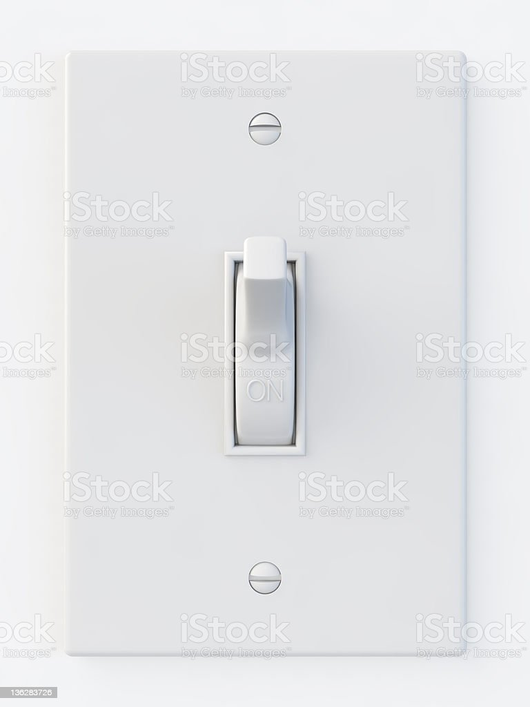 White light switch in the on position stock photo
