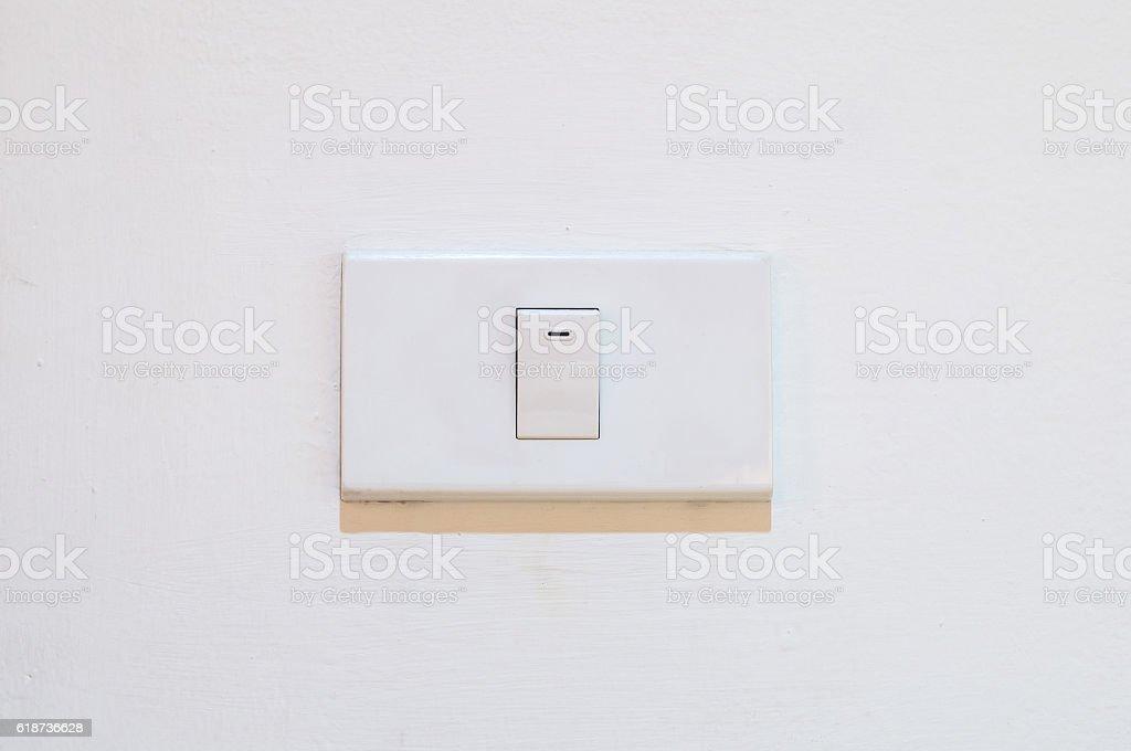 White light switch on white wall stock photo