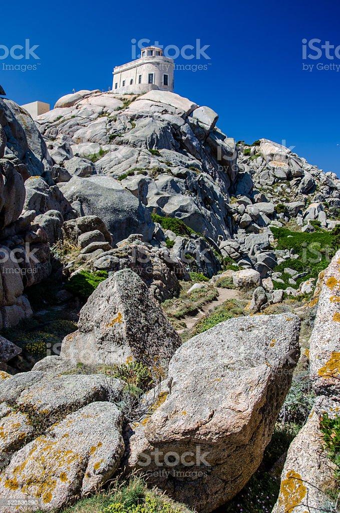 White lighthouse of Capo Testa in north Sardinia stock photo