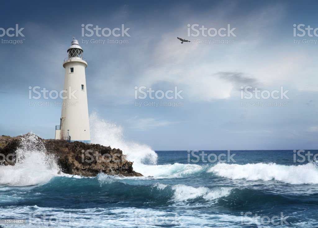White lighthouse on the cliff stock photo