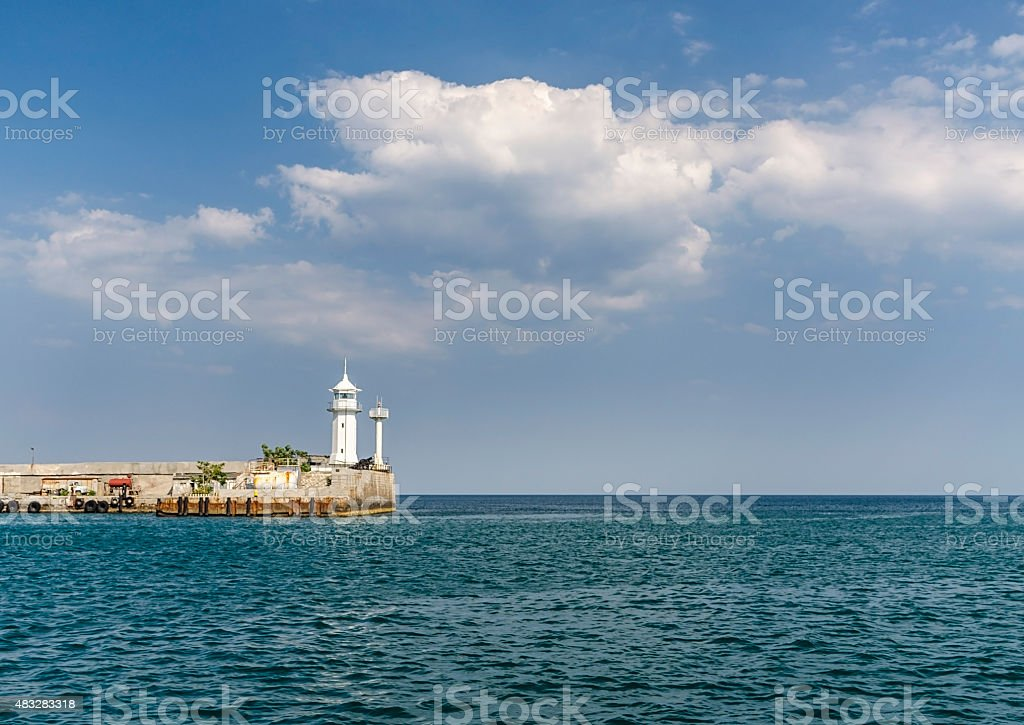 White lighthouse on the pier in city Yalta, Republic of stock photo