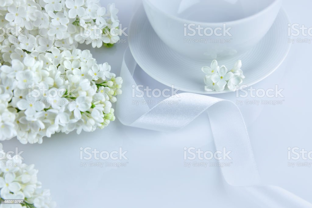 White lilac with white ribbon at the morning stock photo