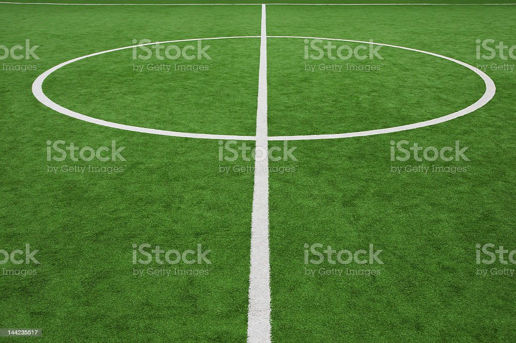 White line and circle in the center of a soccer field royalty-free stock photo