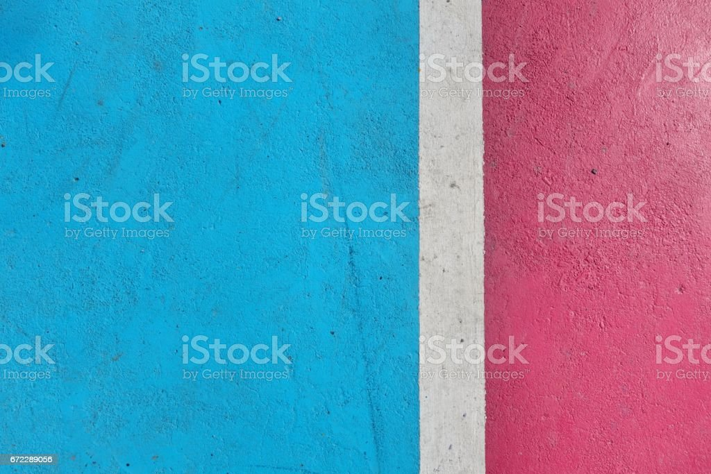 White line on colorful concrete floor of outdoor basketball court. stock photo