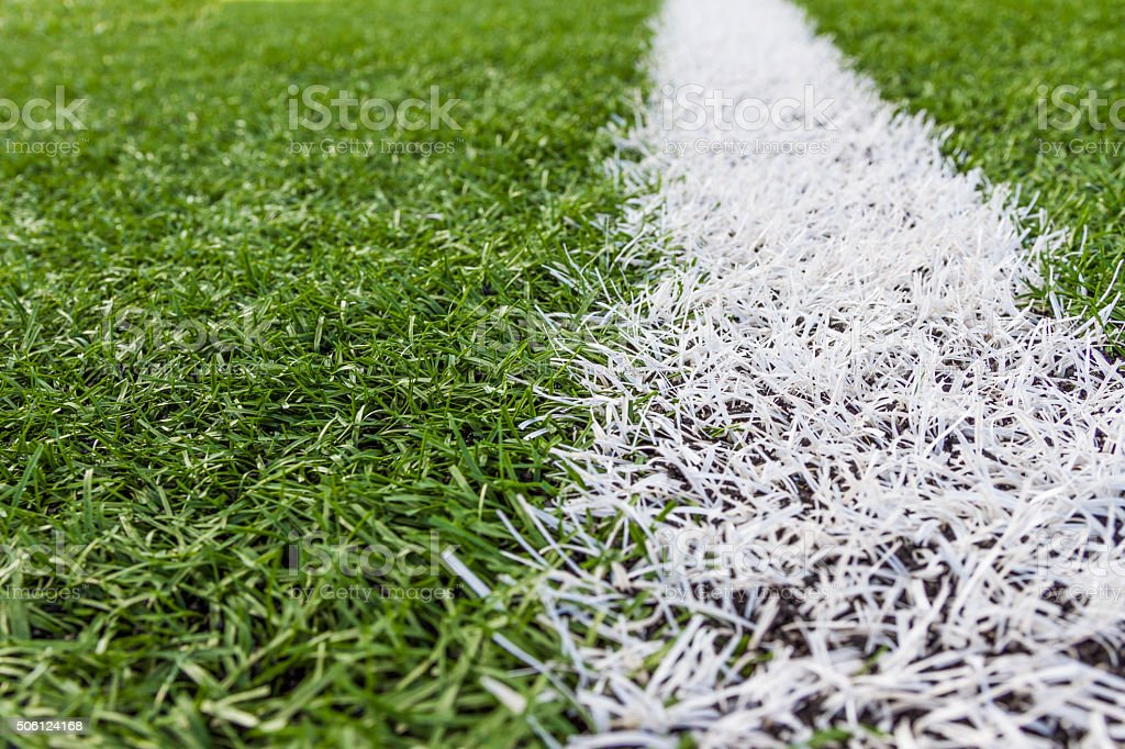 white line on soccer field grass stock photo