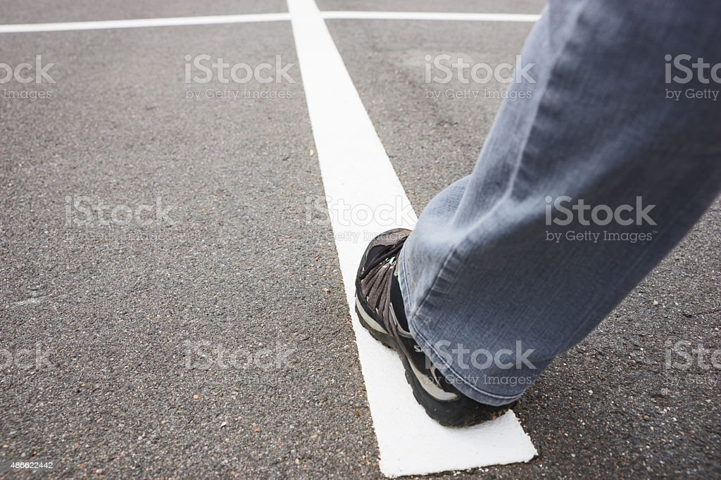 White line on street with walking people stock photo