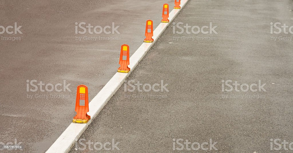 White line reflectors on bicycle path stock photo