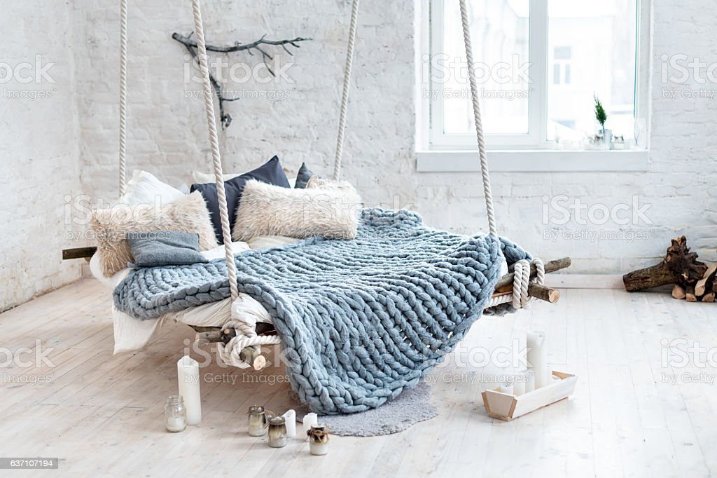 White loft interior in classic scandinavian style. Hanging bed suspended stock photo