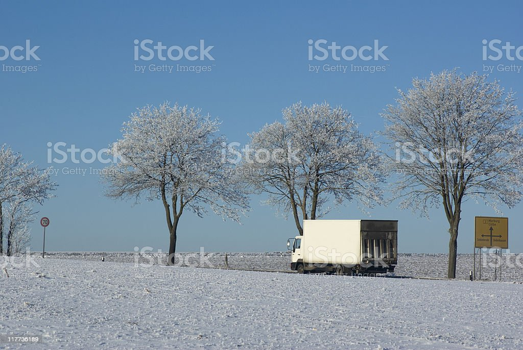 White lorry on the wintry Federal road royalty-free stock photo